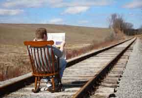 rocking chair on train tracks
